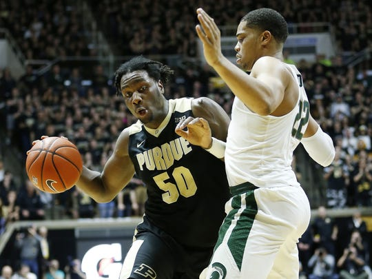 """Caleb Swanigan, left, is Mickey Kor's favorite player on this year's Purdue team. """"Then again,"""" he said, """"who doesn't like him?"""" Kor, a Holocaust survivor and longtime season ticket holder, has had to watch the Boilers from his home from Terre Haute this year as he recovers from health issues. Kor's friends have kept his seat open for him, just in case."""