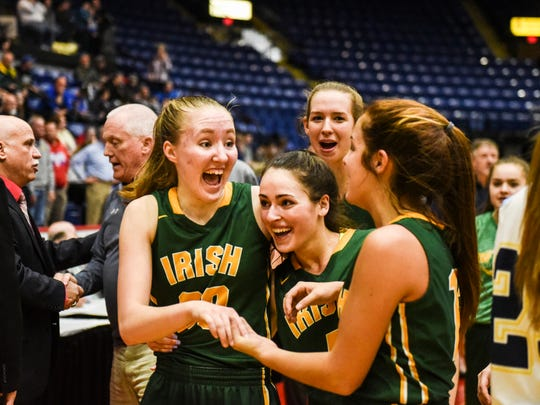 York Catholic's Katy Rader, Gina Citrone and Kate Bauhof celebrate as York Catholic beat St. Basil Academy 40-31 in the PIAA 3A quarterfinals at Santander Arena in Reading, Pa. on  Sunday, March 19, 2017.