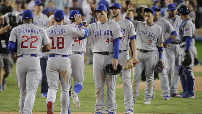 The Chicago Cubs celebrate after Game 4 of the National League baseball championship series against the Los Angeles Dodgers on Wednesday. The Cubs won 10-2 to tie the series 2-2.