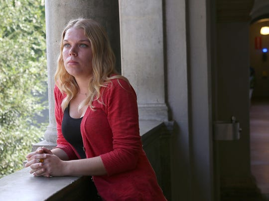 Ashley Adkins, who grew up in foster care homes, is photographed at Riverside City College on Sept. 21.
