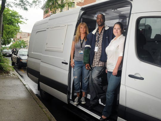 Members of the Hudson Valley Community Services Project Reach Out team with the outreach van in the City of Poughkeepsie, from left: Cynthia Cuccia Montagnino, prevention specialist; Maurice Bacote, peer; and Jackie Perez, program supervisor.