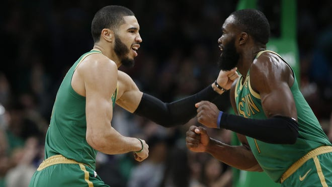 Jayson Tatum, left, leads the Celtics with 23.3 points per game, while Jaylen Brown is averaging 20.5 points this season.