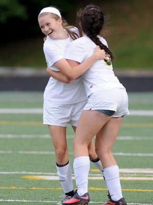 Reynolds graduate Megan McCallister, left, scored 152 goals in her high school career.