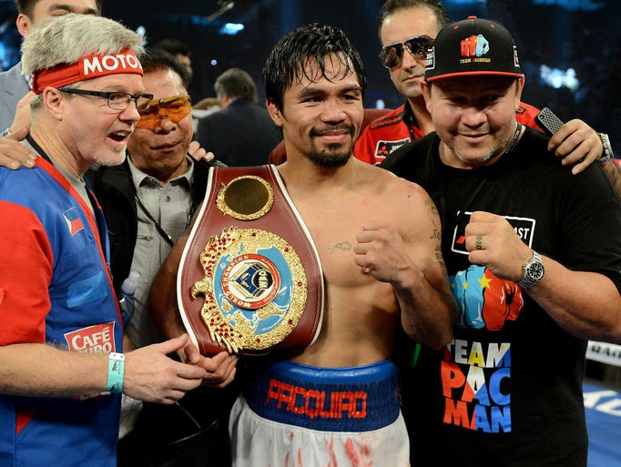 Manny Pacquiao in the ring after his WBO World Welterweight Championship fight against Timothy Bradley Jr. (not pictured) at the MGM Grand Garden Arena. Manny Pacquiao won by decision.