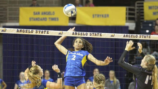 Angelo State University middle blocker Morgan Seaton (2) goes up for a kill attempt against New Mexico Highlands at the Kathleen Brasfield ASU Invitational at the Junell Center on Saturday, Sept. 2, 2017.