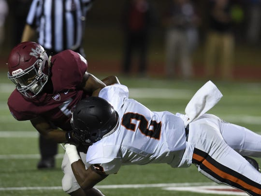 Ensworth's Rodney Owens, 2, tackles MBA's Micah Battle,