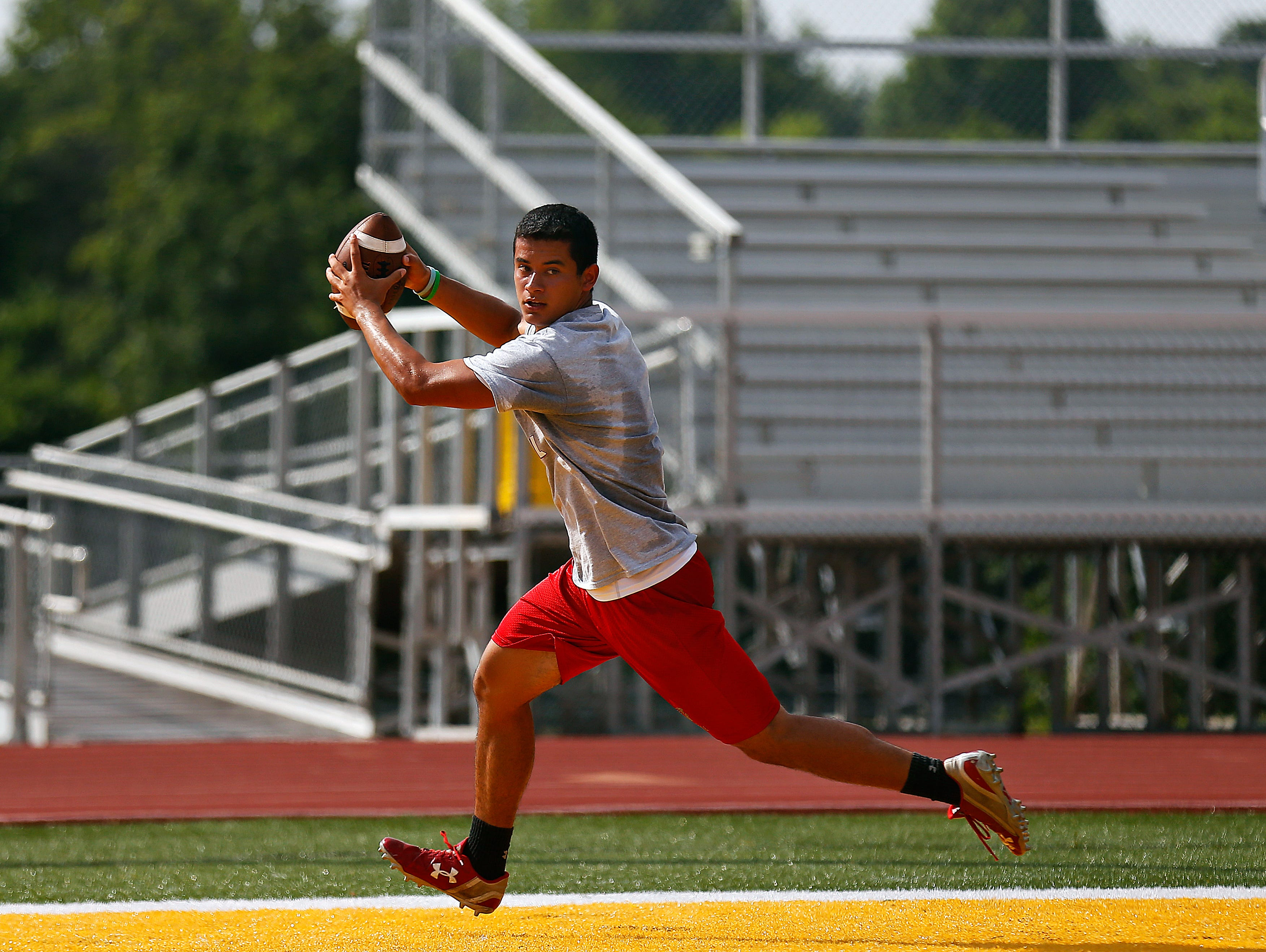 Nixa High School wide receiver Nicos Oropeza catches a touchdown pass as the Eagles play West Plains High School during the 2016 Parkview 7 on 7 Tournament held at JFK Stadium in Springfield, Mo. on June 16, 2016.