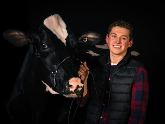 Joseph Opsal of Dane County was named Outstanding Holstein Boy at the recent WI Jr Holstein Convention. Opsal plans to take over the family's registered Holstein dairy farm while running a small photography business on the side.