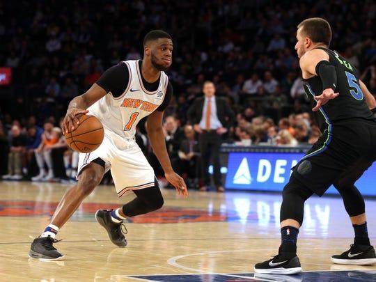 New York Knicks point guard Emmanuel Mudiay (1) controls the ball against Dallas Mavericks point guard J.J. Barea (5) during the fourth quarter at Madison Square Garden.