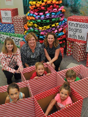 At Manatee elementary in Viera, students of grades K-6,along with teachers and several parent volunteers are making efforts to promote kindness and giving back to he community. The kids in this photo  are Lindsey Daly, Kathryn Olson, Audrey Evans (closest to camera), and Cooper Hensley. The parent volunteers are Robyn DeKeyser, Nicki Hensley (who is also P.T.O. president) and Catherine Evans.