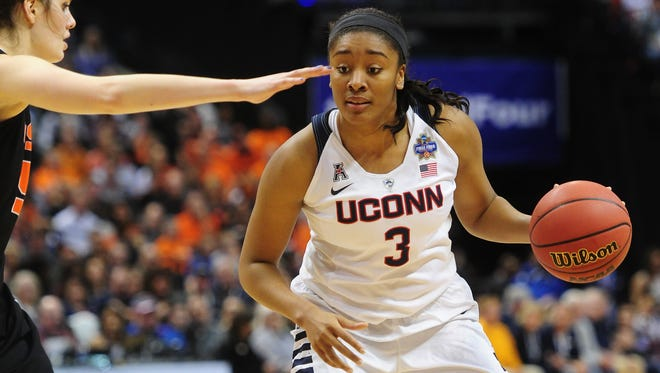 UConn forward Morgan Tuck dribbles the ball in front of Oregon State forward Samantha Siegner during the fourth quarter at Bankers Life Fieldhouse.