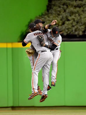 August 15: Giants outfielders, from left to right,