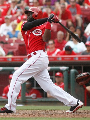 Cincinnati Reds second baseman Brandon Phillips (4) hits a solo home run off San Francisco Giants relief pitcher Yusmeiro Petit.
