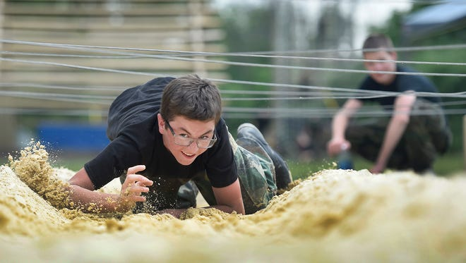 Asher Alderett, 13, crawls through sand under ropes, competing for bragging rights during a physical test of endurance at Civil Air Patrol Cadet Training School at Fort Indiantown Gap this week. Approximately 192 cadets from Pennsylvania, Connecticut, Ohio, Virginia, New Jersey and New Hampshire participated in the eight-day program designed to 'build their confidence, their skills, and knowledge,' said Melissa Parker, Public Affairs Officer for Cadet Training School.