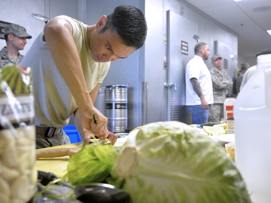 Cooks from Malmstrom, F.E. Warren, and Minot Air Force Bases compete in a cooking competition judged by celebrity chef Robert Irvine on Thursday in the Grizzly Bend kitchen at Malmstrom Air Force Base.