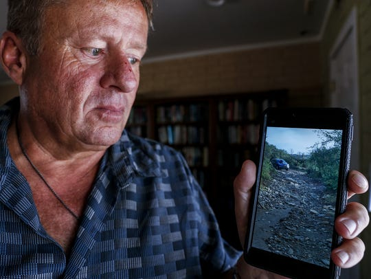 Michael Ohman shows a photo of where he was stranded