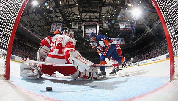 Kyle Okposo scores against Petr Mrazek on Sunday during the Wings' loss to the Islanders.