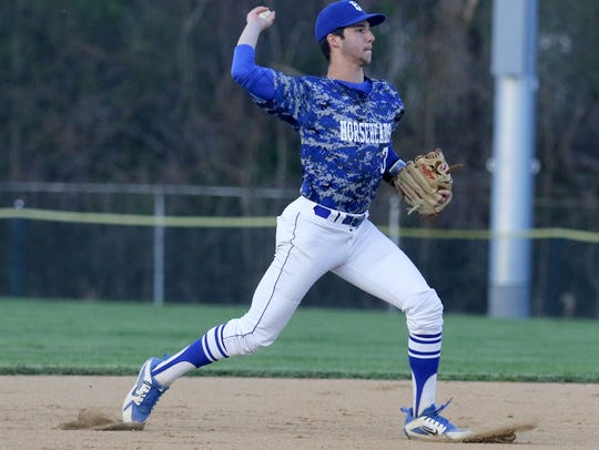 Horseheads shortstop Mike Limoncelli throws to first for an out in a 14-2 win over Elmira at Elmira High School.