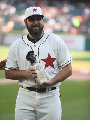 Tigers' Michael Fulmer is presented with the Larry Doby Legacy Award by the Negro League Museum before action against the Indians on July 1, 2017 at Comerica Park.