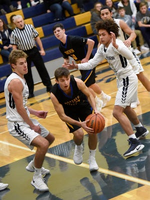Northern Lebanon's Alex Yeager drives through the key during Thursday night's match up against Penn Manor. The Vikings lost 54-51.