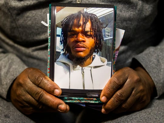 Margie Cropper-Frazier holds a photo of her son, Antonio Cropper, in her home in West Center City on Monday afternoon, December 7, 2015. Cropper was shot and killed near the corner of Jefferson and Seventh Streets on June 15, 2015.