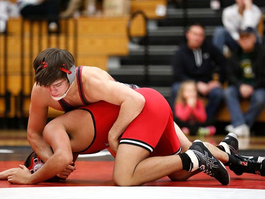 Fond du Lac's Josh Adams holds down a Neenah wrestler Tuesday night at Fond du Lac.