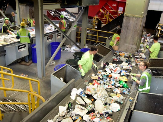Penn Waste recycling center sorters work along a conveyor Friday, March 25, 2016. Penn Waste is urging customers to contain medical waste, like dirty needles, and dispose of it in their regular trash for the safety of their workers. Bill Kalina photo