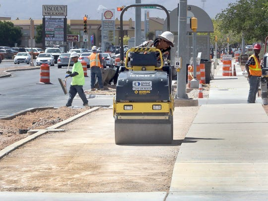 Workers for Martinez Brothers Contractors, LLC prepare roadbed for a new bike lane along Viscount Blvd. between Montwood Drive and Hawkins  Blvd. Tuesday. The lane will be separated from the street by a median that will be decorated with bushes and shade trees, a workers on the scene said.