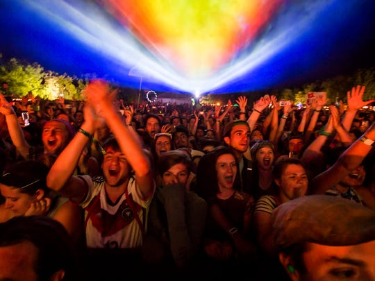 Fans cheer as Tame Impala performs at the Backyard Stage at the Firefly Music Festival in Dover on Friday night.