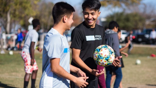 Jose Mejia, left, and Miguel Paredon were hired as program specialists for Upper Ninety after completing the program while attending LBJ High School. The after-school program was rebranded to become Verde Leaders on Tuesday.