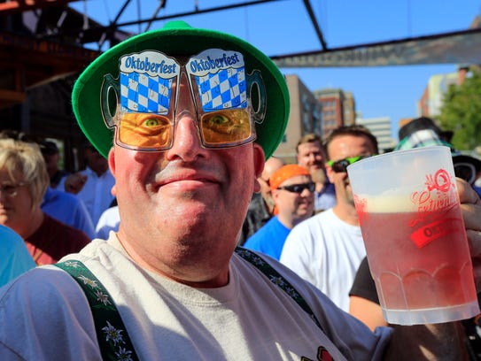 John Heiser of Green Bay drinks a free beer at the