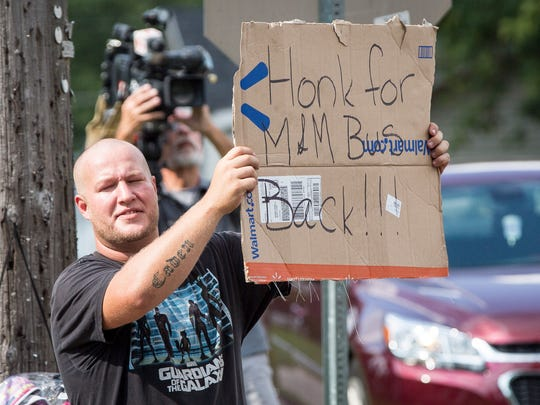 A small protest of parents and their children broke out at West 15th Street and South Port Avenue on Aug. 2 after tensions over busing issue boiled over. The group wants to bring back M&M busing, the previous bus company before Muncie Community Schools switched to Auxilio, a company based in Lansing, Mich..