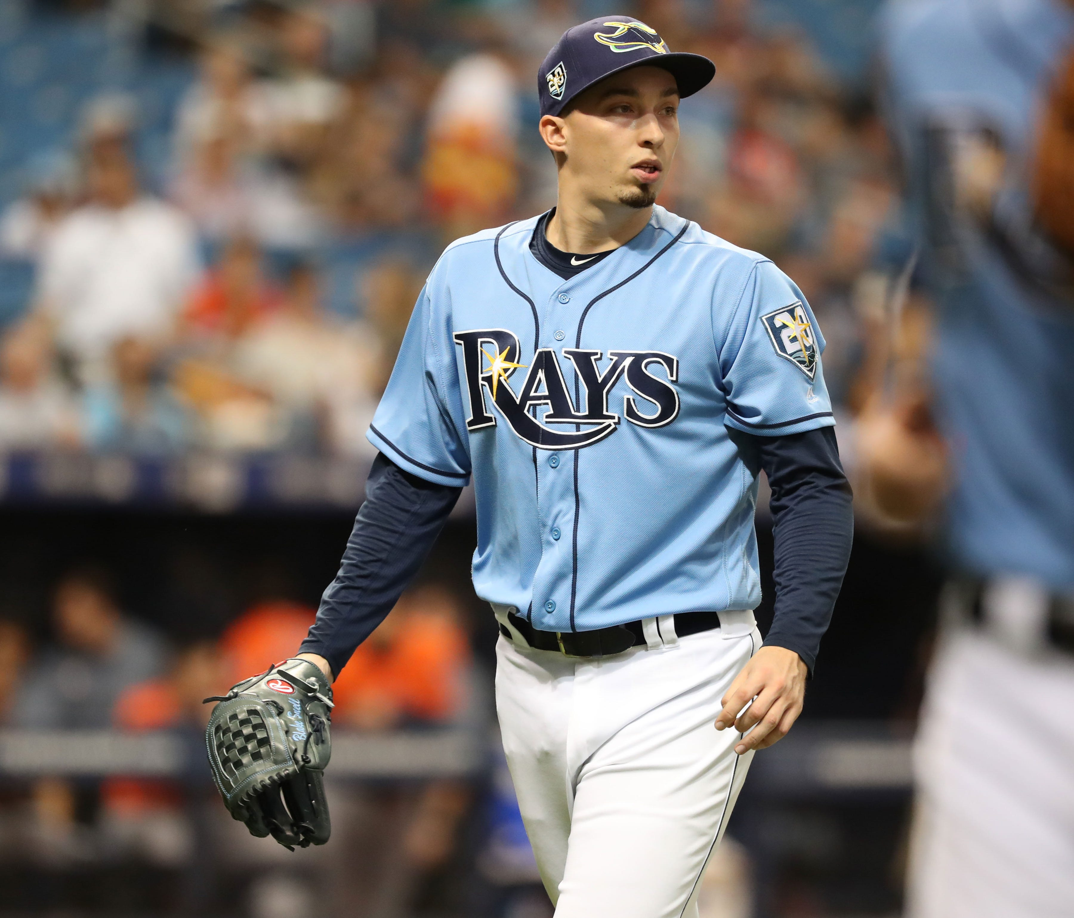 Blake Snell leads the AL in ERA (2.09) while tying for second in wins (12).