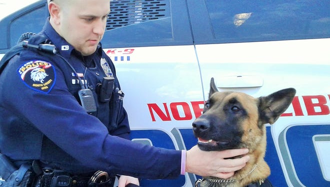North Liberty's first police dog, Falco, gets a chin scratch from his handler, officer Ben Campbell.  The dog excels in drug detection, person/article tracking and handler protection, can wear a GoPro camera if needed and will soon have his own custom-fitted ballistic vest.