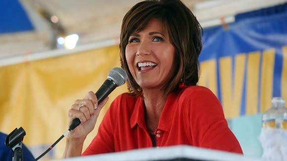 U.S. Rep. Kristi Noem debates with Corinna Robinson during Dakotafest in Mitchell on Tuesday, Aug. 19, 2014.
