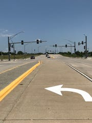 This left-turn lane serves no real purpose because there is not a road to turn left onto. This is near the Mercy Orthopedic Hosptial on East River Bluff Boulevard, commonly called Evans Road.