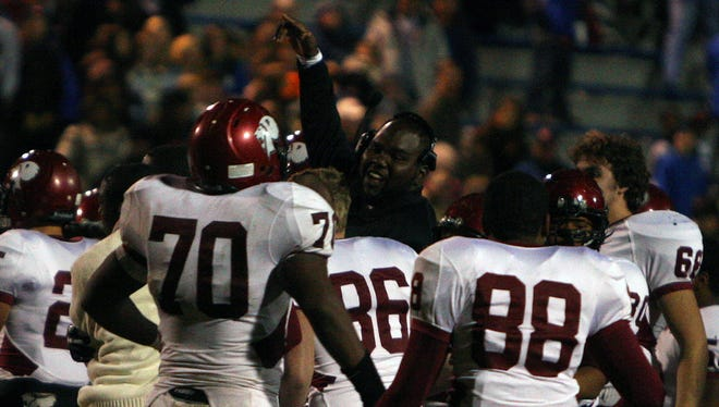As the final seconds ticked away on the play clock, Prattville's Coach Antonio 'Bam' Richards, surrounded by a pride of lions, took the field in celebration of their win against Auburn and upcoming match up against Hoover at Bryant/Denny Stadium for the 2014 State Championship.