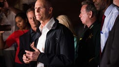 Florida Gov. Rick Scott speaks to news media near Marjory