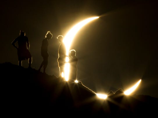 Hikers watched a partial solar eclipse in Phoenix in