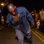 Chainsaw Pete searches for his next victim during the 11th Annual Louisville Zombie Attack. August 29, 2015.
