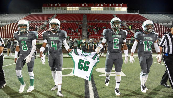 Collins players carry the jersey of Jabarri Goudy (66) before the game against Philadelphia at Petal High on Nov. 6. Goudy was killed in a shooting outside a Hattiesburg nightclub in July.