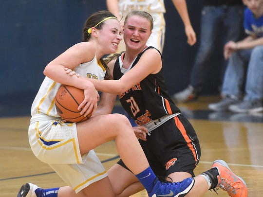 Northern Lebanon guard Zoe Zerman and Palmyra Cougar Molly Gundermann battle for possession in the 4th quarter of the Northern Lebanon Tip-Off Championship game Saturday, Dec. 5. The Vikings defeated the Cougars.