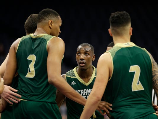 In this photo taken Tuesday, Nov. 21, 2017, Sacramento State guard Kevin Hicks, center, huddles with his teammates during the second half of an NCAA college basketball game against UC Davis, in Sacramento, Calif. Hicks broke down in his first trip back to the 9th Ward of New Orleans since Hurricane Katrina uprooted his family. The bones are what hit Hicks. Not the house that was destroyed, not the devastation still apparent three years later, not the clothes wadded up in the corner of what was once his bedroom. No, the bones of the family dog scattered in the yard are what did it.(AP Photo/Rich Pedroncelli)