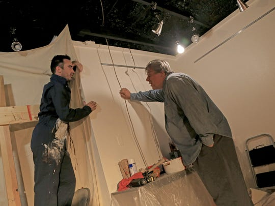 "Jesse Nepivoda, as Ken, speaks with Varlo Davenport, as Mark Rothko, in Rothko's studio during The Space Between Theatre Company's production of ""Red"" at the DiFiore Center in St. George."