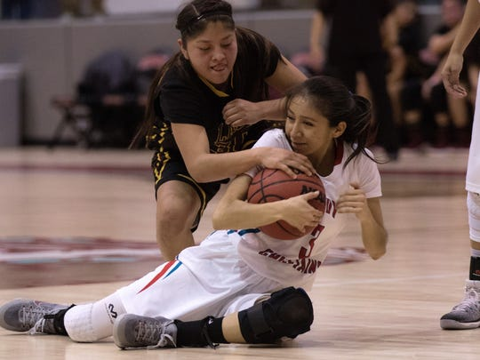 Shiprock's Kylie McKinley protects the ball from Tohatchi's Cheyenne Begay on Monday at the Chieftain Pit in Shiprock.