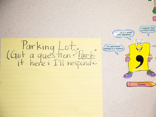 """A large sheet serves as a """"parking lot"""" for students to ask questions of English teacher Kimberlyn Slagle at David Thibodaux STEM Magnet Academy."""