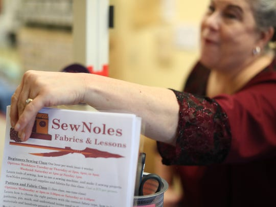 Martha Heath, owner of SewNoles, works with students at her Midtown shop on Thursday, April 5, 2018. Heath's store helps people learn the art of sewing through classes that start at beginner levels and progress through clothing measuring and creation.