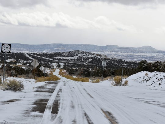 A snow-covered landscape is pictured Monday at the intersection of N.M. highways 575 and 173 east of Aztec.