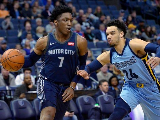 Detroit Pistons forward Stanley Johnson (7) drives against Memphis Grizzlies forward Dillon Brooks (24) in the first half of an NBA basketball game Sunday, April 8, 2018, in Memphis, Tenn.