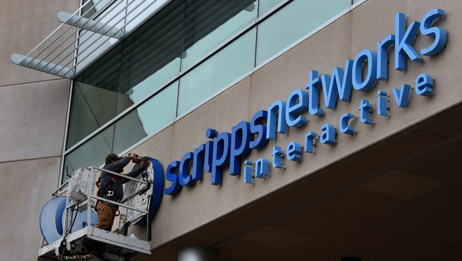 The formal takeover of Knoxville-based Scripps Networks Interactive by Discovery Communications took place Tuesday and the exterior signage is already changing Wednesday, Mar. 7, 2018.